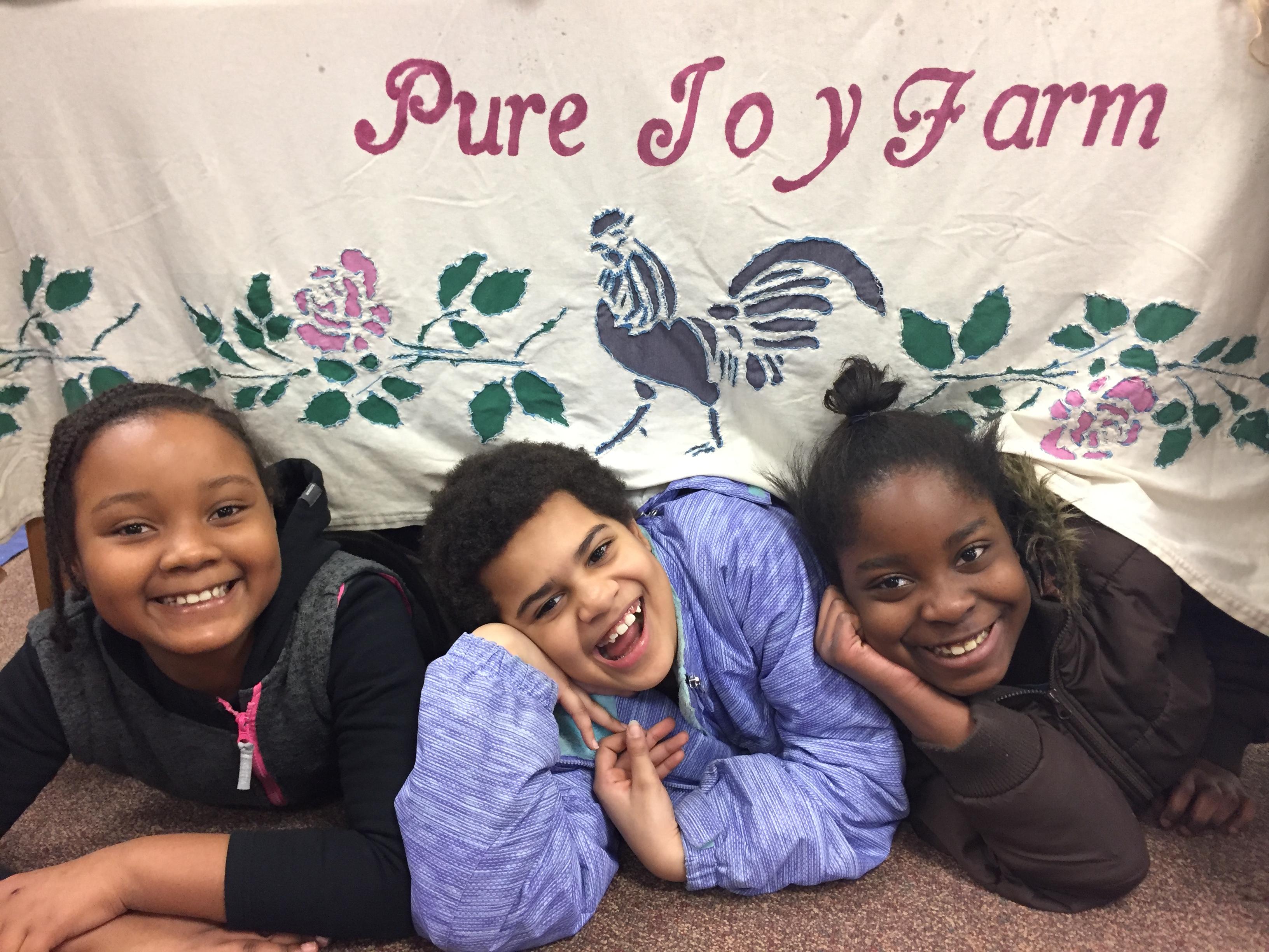 Kids under banner